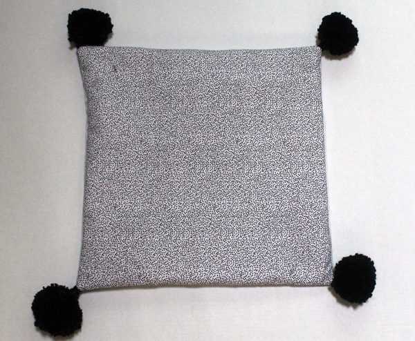A Pillow with Giant Pom Poms