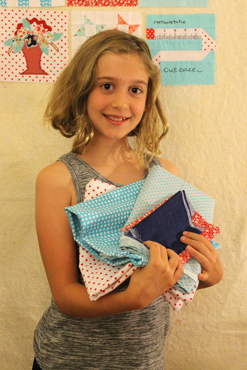 Addison with fabric for block 27, sewing machine