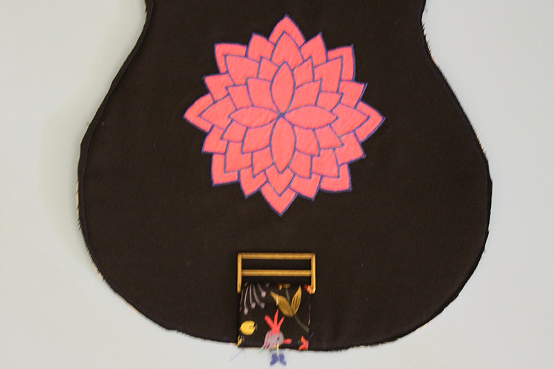 "I stitched the Annie and the exterior back together first then I put the ""peace, love, uke"" embroidery on the back of the headstock section and a cool mandala applique on the body."